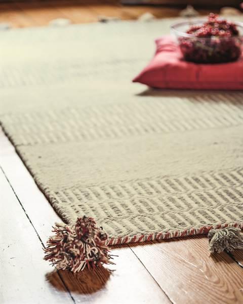 Teppich grau mit Troddeln
